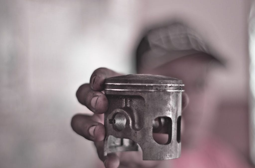 Hand Holding a Piston Ring | PPUK